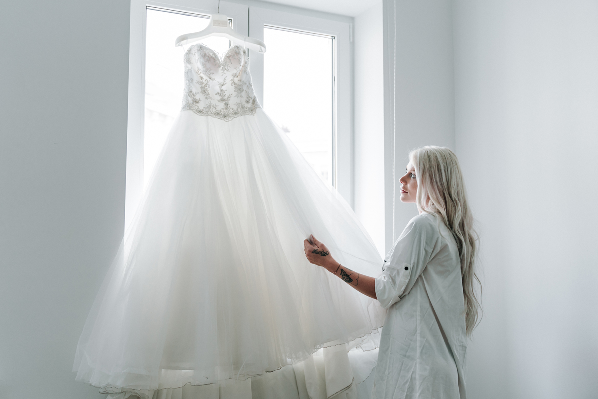 Bride touch her wedding dress before Vienna wedding photos shoot by Melbourne wedding photographers Lowina Blackman