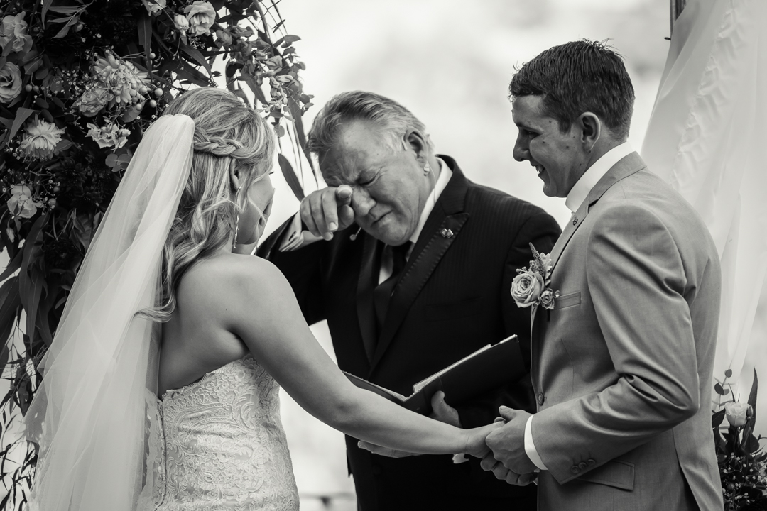 emotional photo showing marriage celebrant Greg Evans cried during Wilson Botanic Park Berwick Wedding ceremony captured by Lowina Blackman from Black Avenue Productions