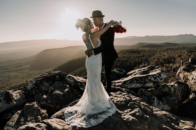 Pre wedding kissing on the mountain sunset sunrise back light style sunset sunrise