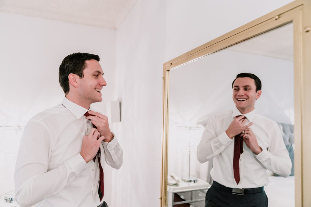 groom is getting ready to marry, dressing up