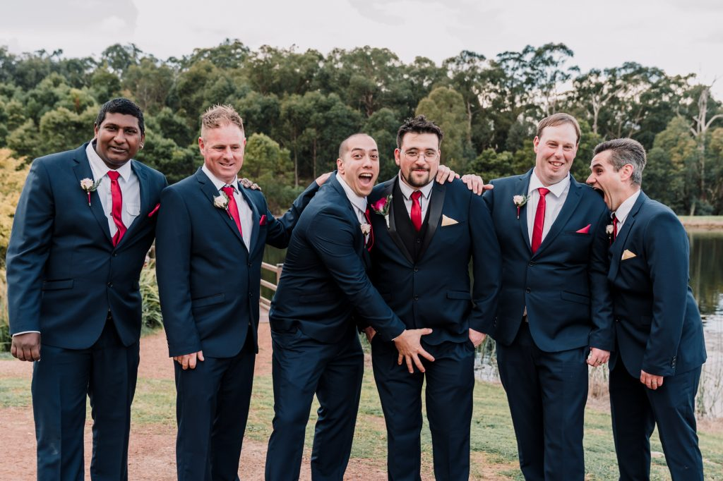 Groomsmen having fun for their bridal party photo session at RACV Healsvelle