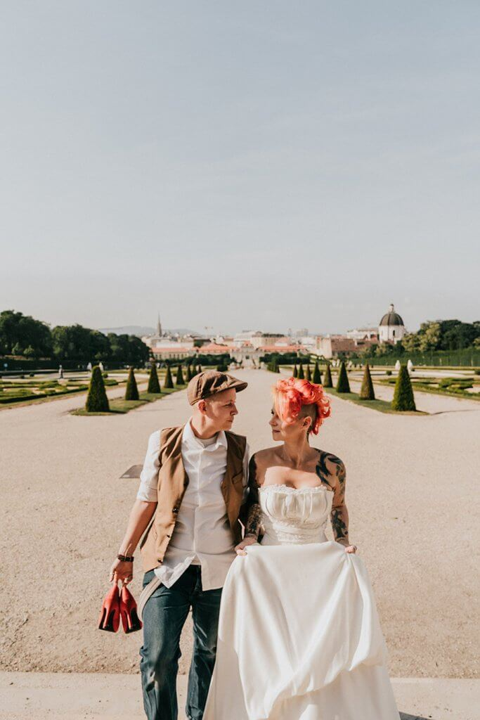 Destination wedding in Vienna showing tattooed same sex lesbian bride and bride taken by photographer Dr. Derek Chan from Black Avenue Productions in Europe