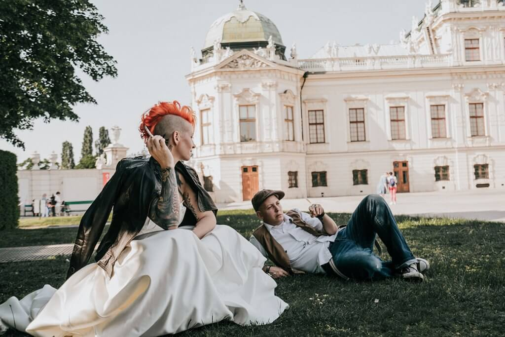 Destination wedding in Vienna showing tattooed same sex lesbian bride and bride taken by Lowina Blackman from Black Avenue Productions in Europe