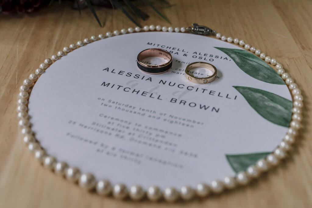 Beautiful pearl Chanel necklace and wedding rings details photo by Melbourne wedding photographer Derek Chan