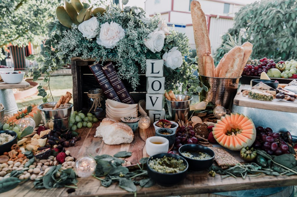 wedding details shot showing a rustic bridal table fill with tasty foods for pre reception nibbles