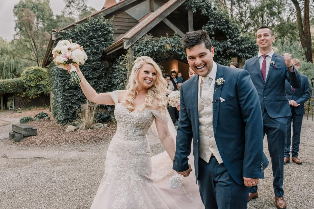 Melbourne couple Amanda and David cheering after got married in Inglewood Estate Wedding captured by Derek Chan from Black Avenue Productions featured on Polka Dot Bride magazine