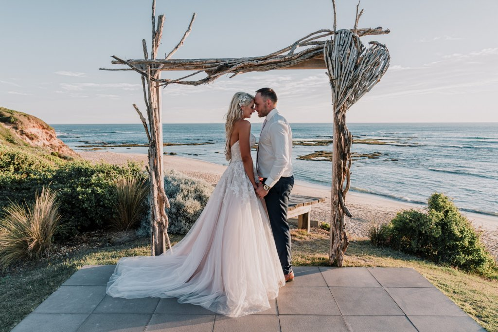 Melbourne couple JoJo and Dan in front of All Smiles beach wedding ceremony as Wedding of the year by Easy Weddings