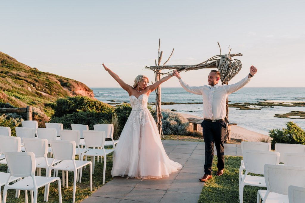 Melbourne couple JoJo and Dan celebrating their All Smiles beach wedding candid moment captured by award winning wedding photographers Derek Chan from Black Avenue Productions
