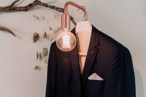 Groom suit jacket hanging artistically taken by Black Avenue Productions