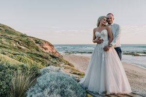 Melbourne couple enjoying a moment after their All Smiles beach wedding ceremony captured by award winning wedding photographer Derek Chan from Black Avenue Productions