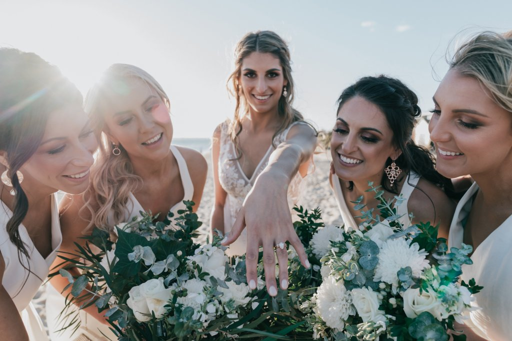 Beautiful bridal party photo at Melbourne beach wedding captured by award winning photographers Derek Chan from Black Avenue Productions