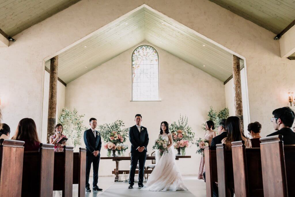 Ceremony at Stones of Yarra Valley Wedding in Melbourne with floral decoration taken by Black Avenue Productions award winning photographer Dr Derek Chan