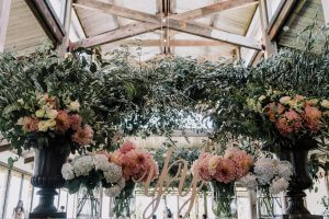 Beautiful rustic theme reception setting with floral arrangement in Stones of Yarra Valley wedding by Black Avenue Productions