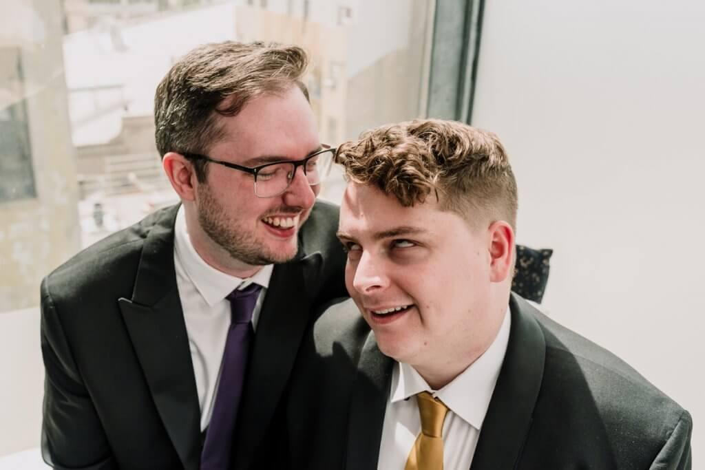 Funny wedding photo idea for 2021 of a same sex couple on their wedding day having a laugh at Mon Bijou Melbourne Wedding venue