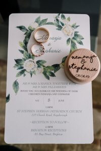 Brighton beach wedding detail shot showing invitation card and wedding rings