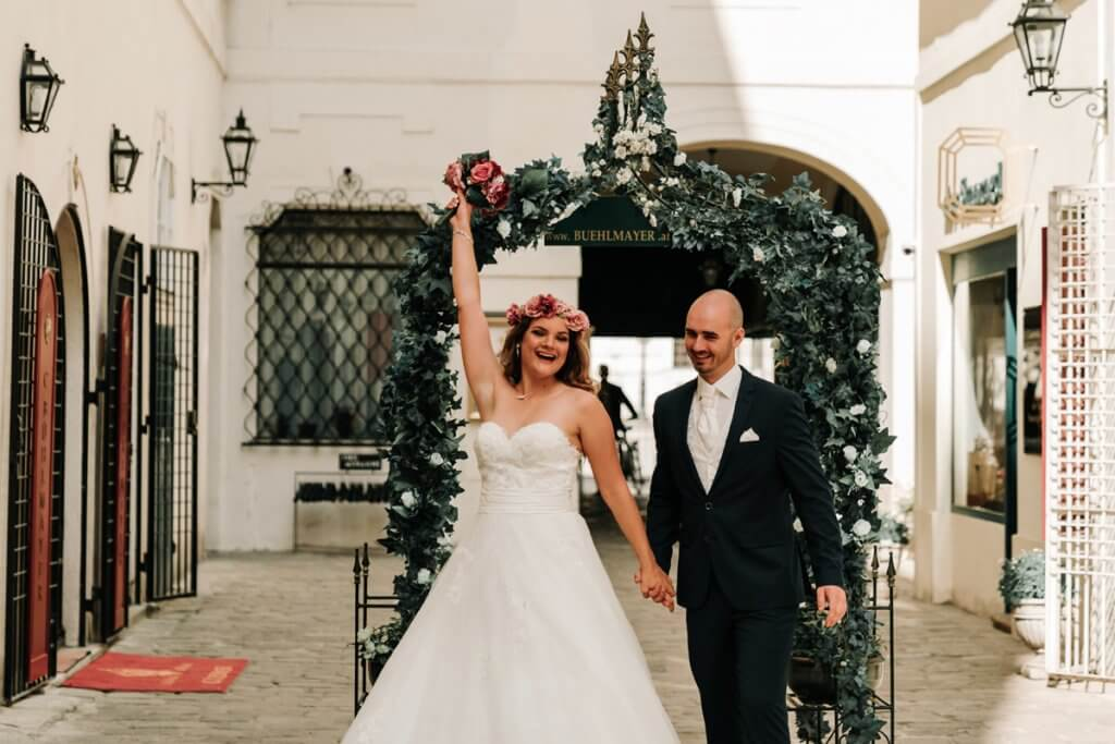 happily married couple Marta and Stefan cheering after wedding ceremony in Vienna for their Europe photo shoot by Black Avenue Productions from Melbourne wedding photographers team