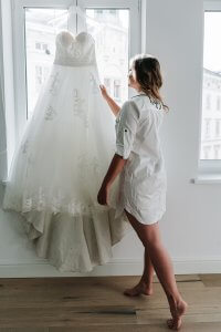 Bride admiring her wedding gown during Europe photo shoot