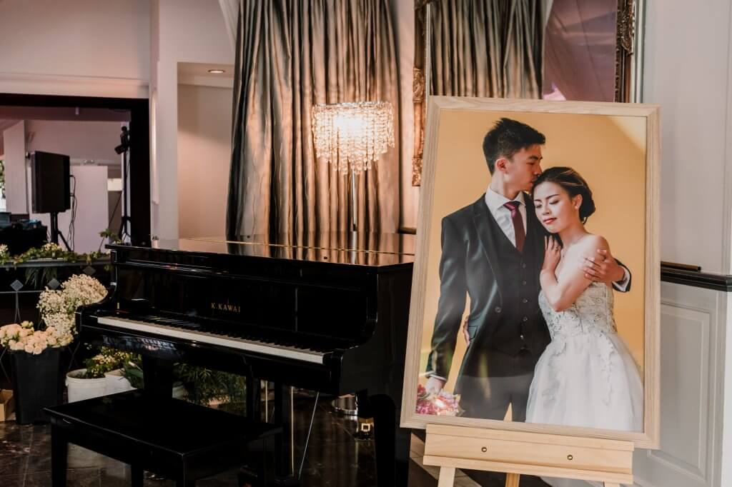 Bride and groom image from engagement photoshoot printed as canvas hanging at wedding reception in Linley Estate
