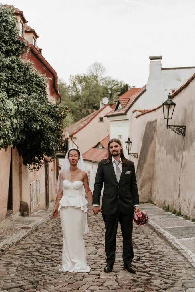 German couples taking wedding photo in Prague by destination wedding photographers Black Avenue Productions image featured in Polka Dot Bride at Expert wedding photographer interview blog