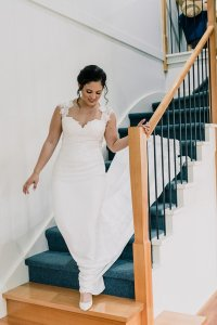 Bride walking down grand staircase for Manor on High wedding ceremony photographed by wedding photographer Black Avenue Productions