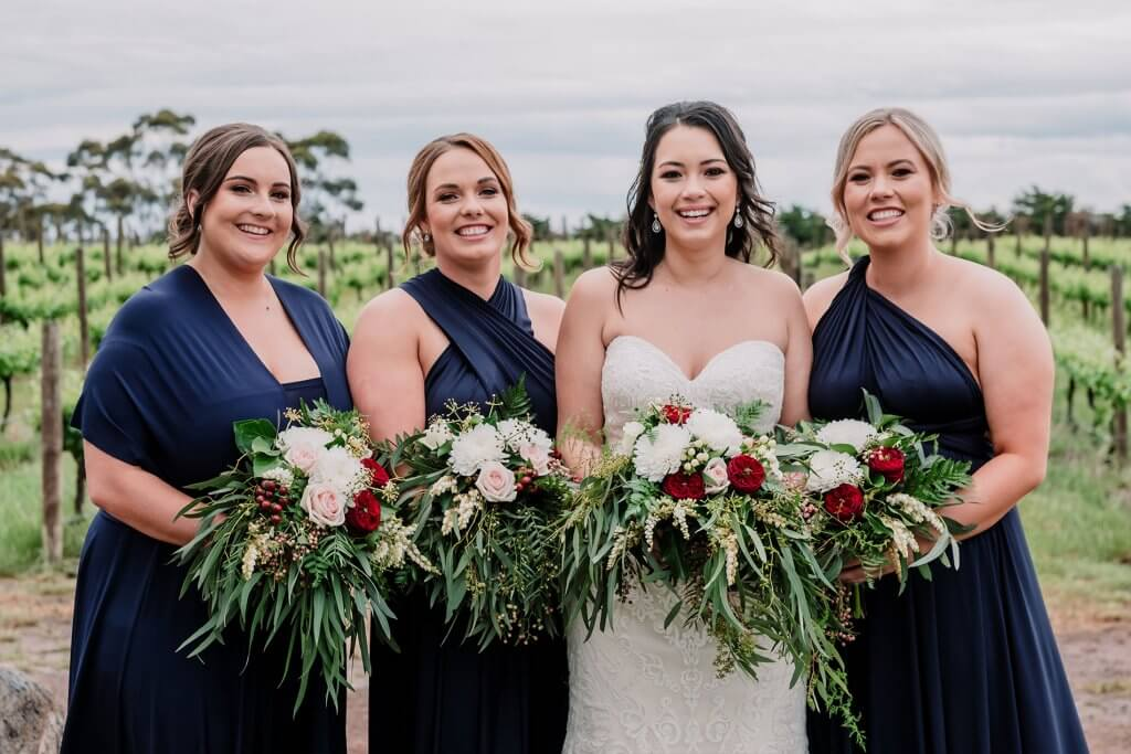 Bridesmaids and Bride at rustic winery wedding