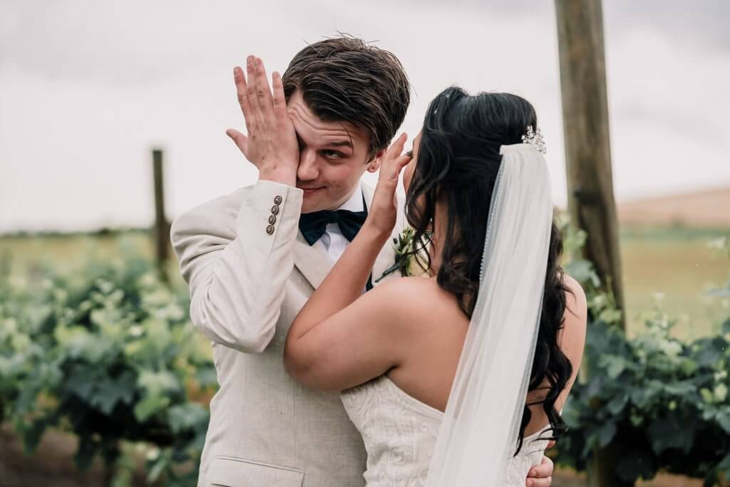 Groom Crying with Bride first look at rustic winery wedding