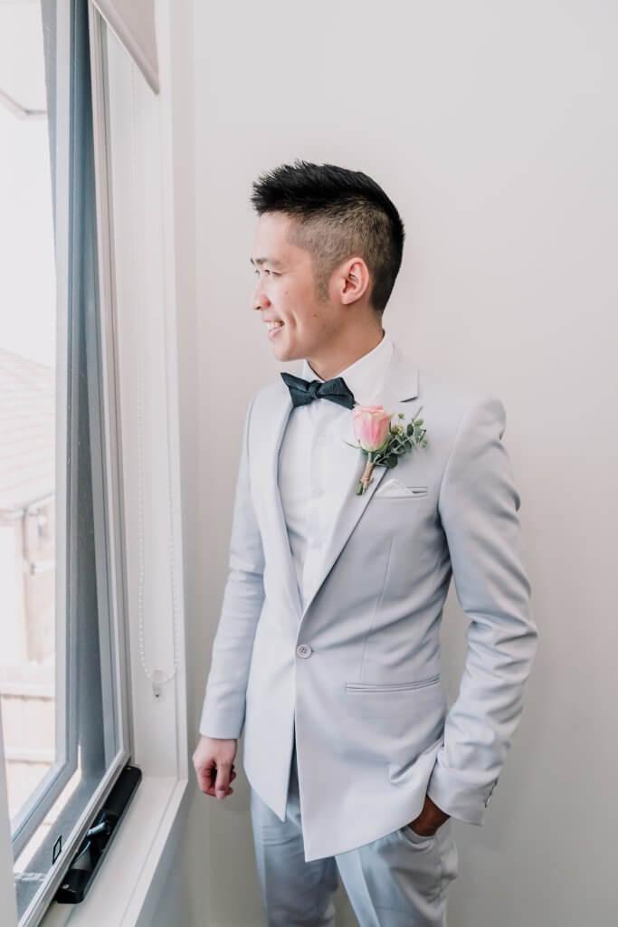 Asian Groom Alvin getting ready for summer wedding