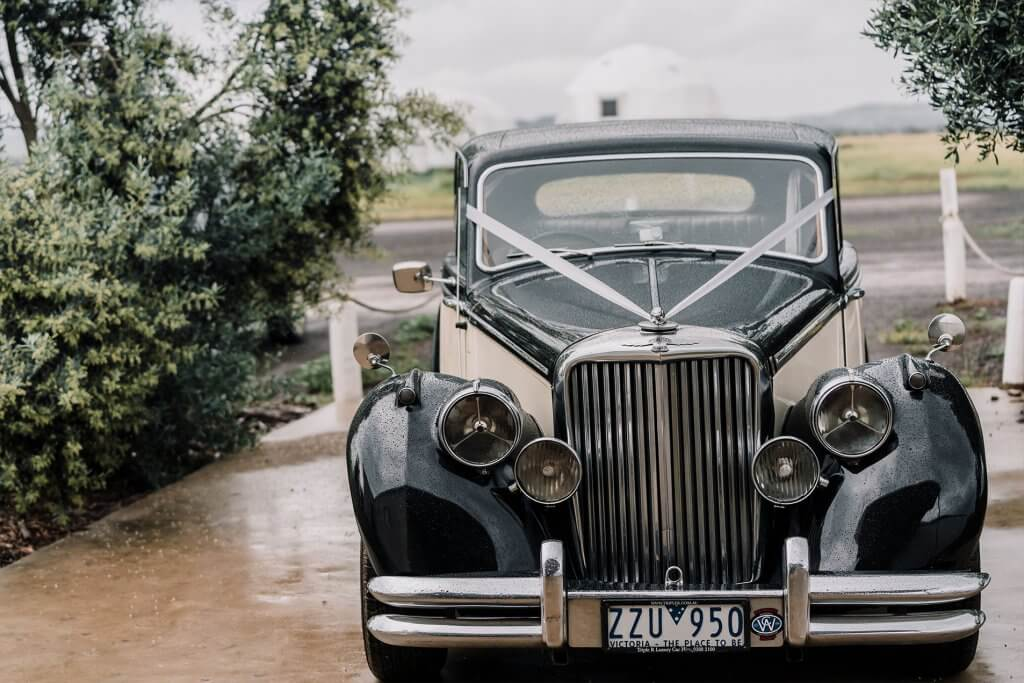 unique wedding car parking at rustic winery wedding
