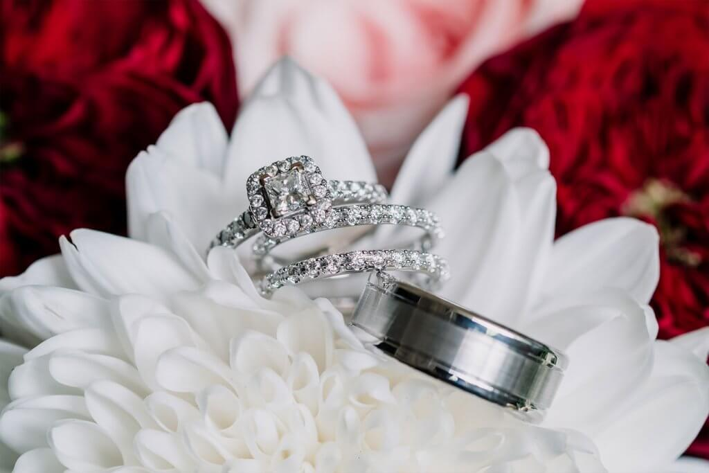 wedding rings on flower