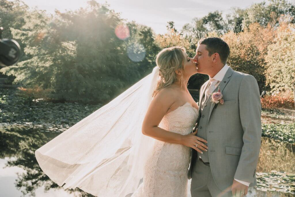 Bride and Groom kissing during the golden hour shot by Black Avenue Productions