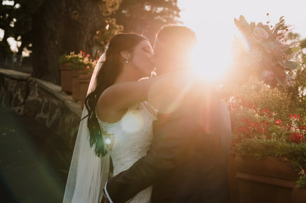 Husband and Wife kissing during the golden hour in Melbourne photographed by Black Avenue Productions
