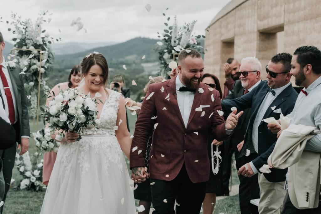 husband and wife in a low-key winery wedding in yarra glen shot by award winning wedding photographers Black Avenue Productions