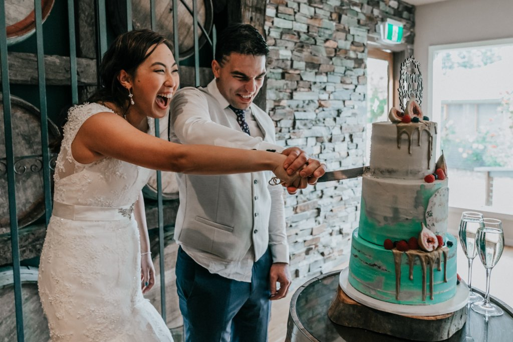 Melbourne bride and groom cutting wedding cake at Inglewood Estate rustic wedding photo idea