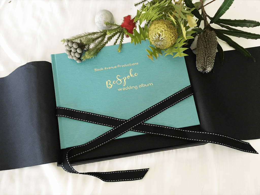 turquoise colored emboss cover of a professionally made wedding album by black avenue productions