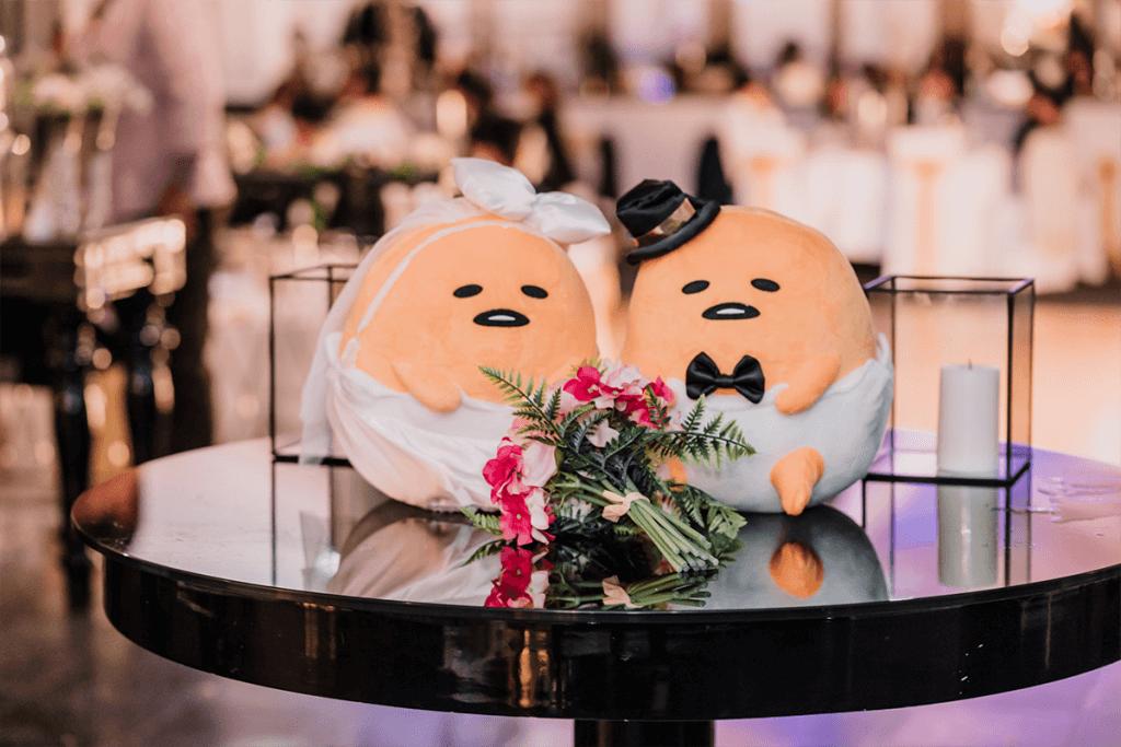 cute bride and groom yolk stuffed toys displayed in a wedding reception