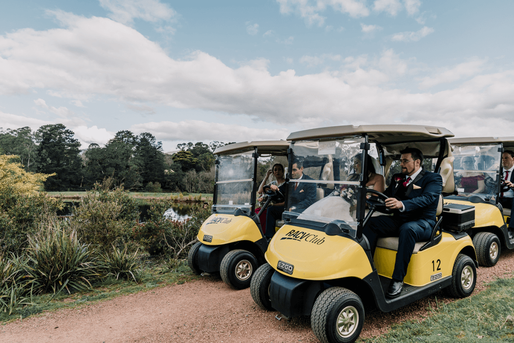 cute yellow mini cars drove by groom and groomsmen