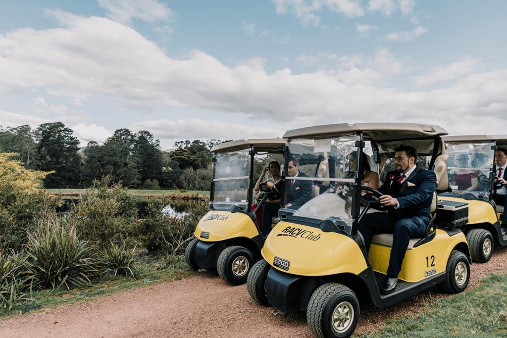 cute yellow mini cars drove by groom and groomsmen
