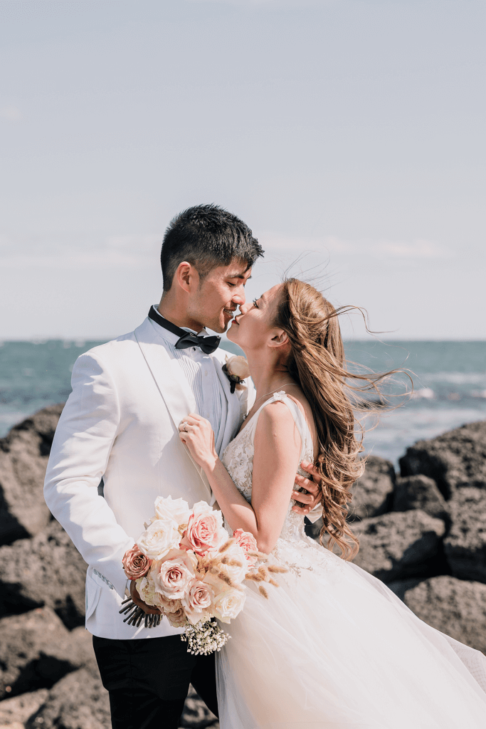 asian couples by the sea in Melbourne shot by black avenue productions