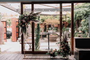 rustic restaurant space in Half acre turned into a wedding ceremony venue