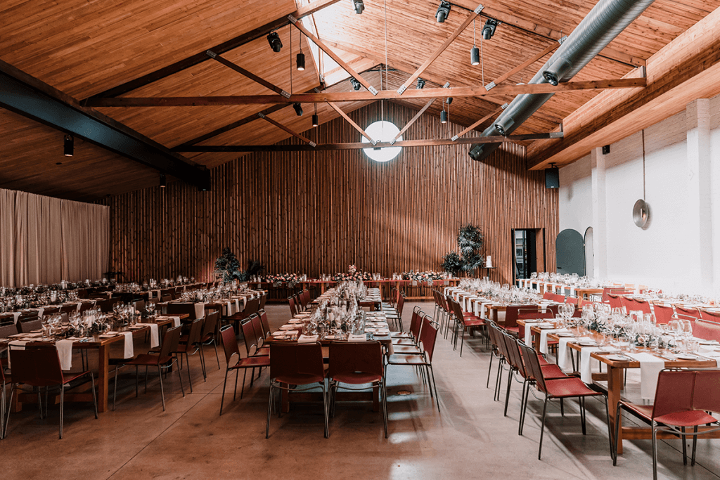 warehouse style venue in Half Acre with triangle ceiling and glass panel