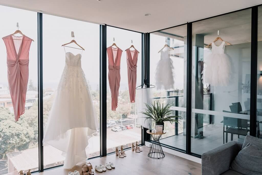 white gown wedding outfit by Luv Bridal and Formal