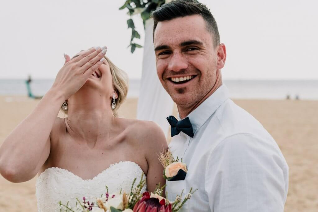 couple laughing in a beach wedding in Brighton Savoy shot by Black Avenue Productions