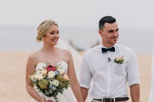 bride and groom at a beach wedding in Brighton Savoy