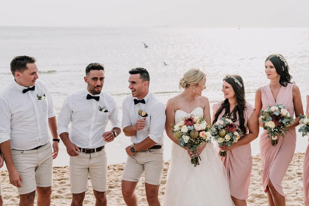 married couple together with bridal entourage in a beach wedding at Brighton Savoy shot by award winning wedding photographers Black Avenue Productions
