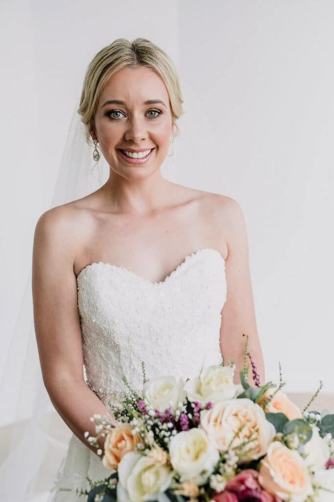 bridal shot with white gown and bouquet shot by award winning wedding photographers Black Avenue Productions