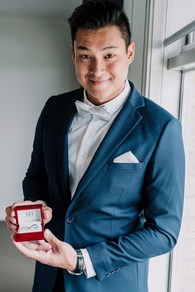 groom holding a ring in the red box before wedding ceremony in Victoria, Australia