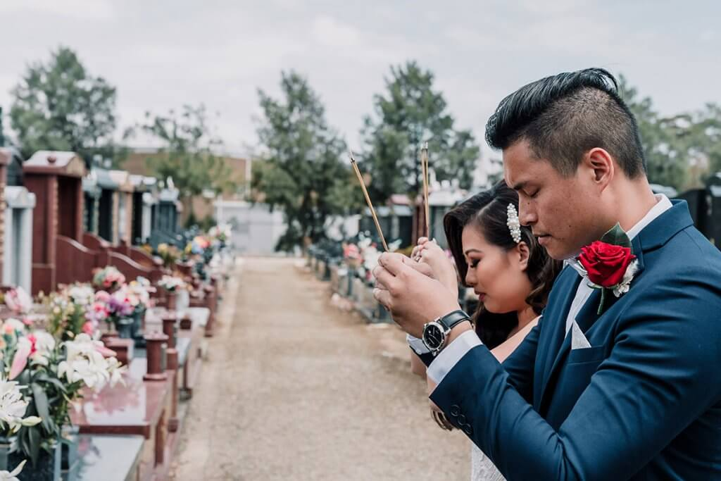 Asian couples praying for their ancestors as part of the wedding ceremony