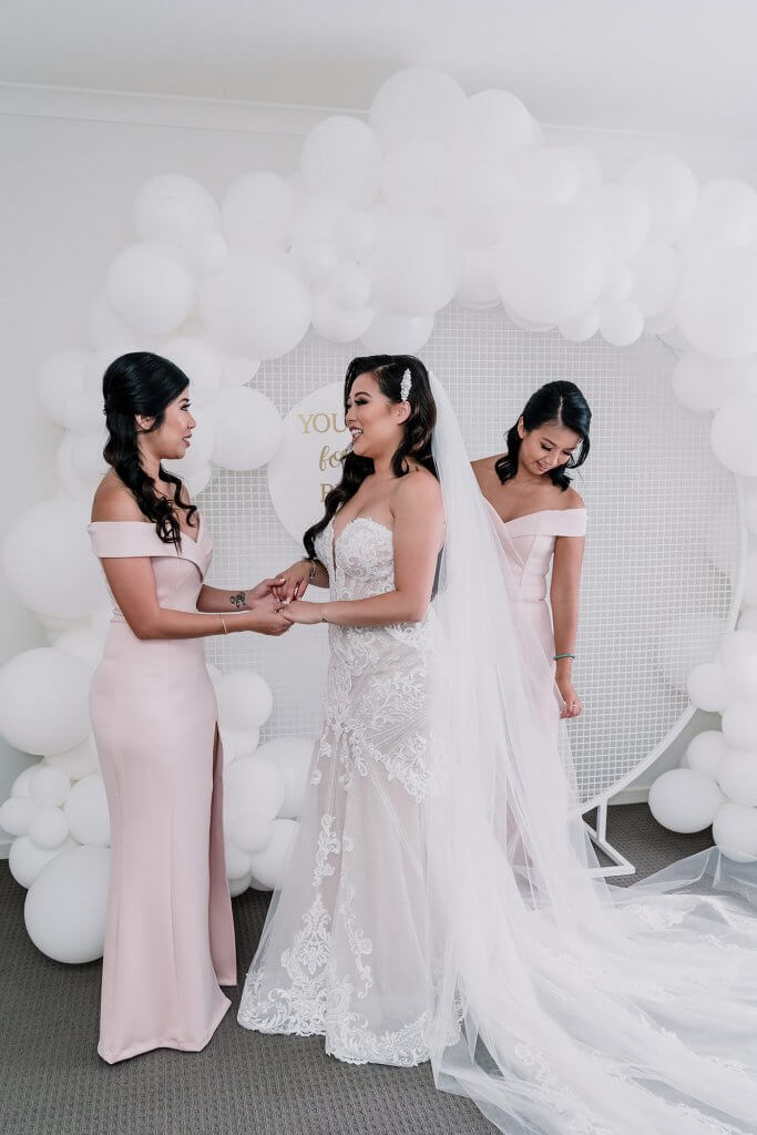 bride with her bridesmaids in a showtime events centre wedding in Australia