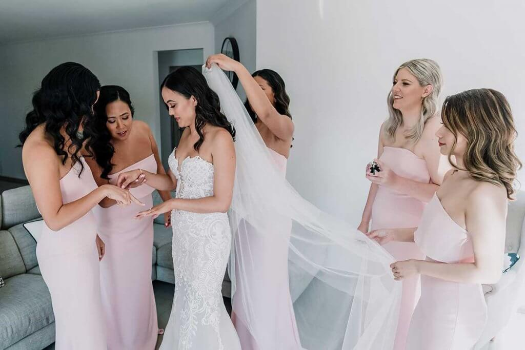 bride getting ready with bridesmaids for meadowbank estate wedding shot by Black Avenue Productions