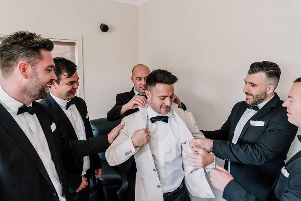 groom getting ready with groomsmen for meadowbank estate wedding shot by Black Avenue Productions